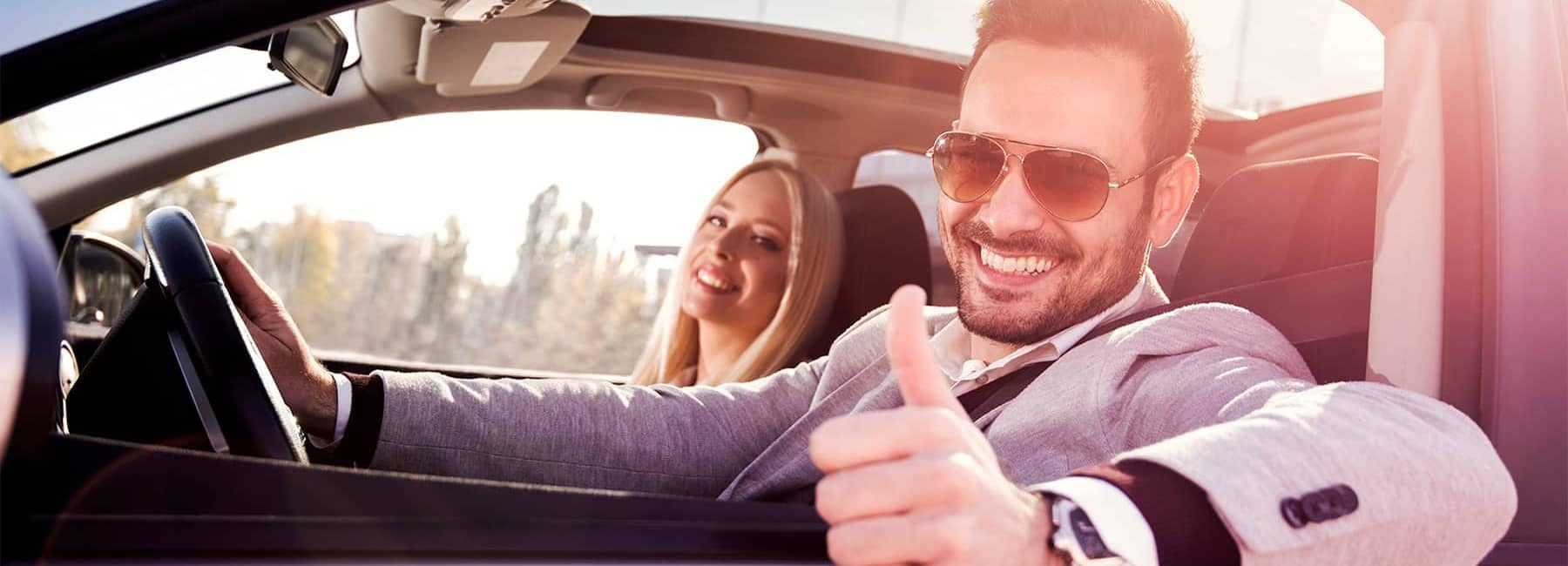 Man Driving Car Giving Thumbs Up
