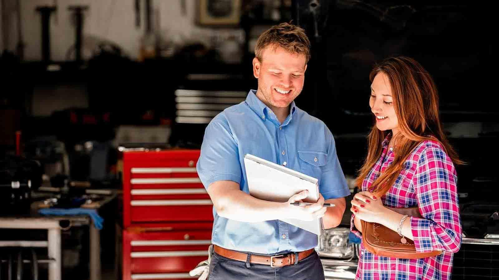 Mechanic showing client inspection