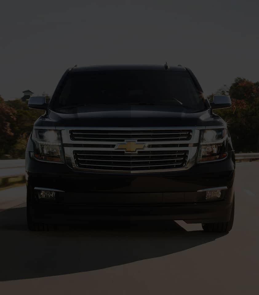 2020 Black Suburban Large SUV Front Grille View