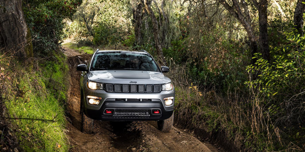 Jeep Compass Off-Roading Through Forest
