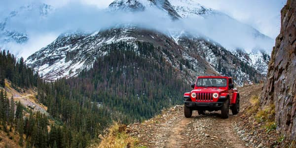 Jeep Wrangler Driving Through Mountain Trail
