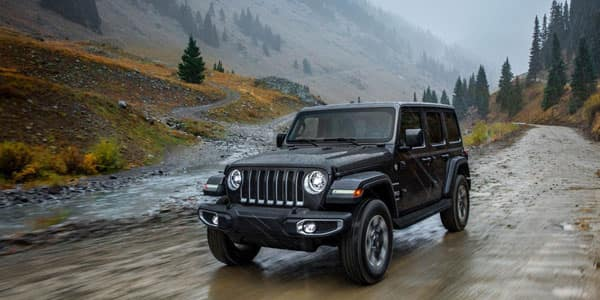Jeep Wrangler Driving on Wet Muddy Trail