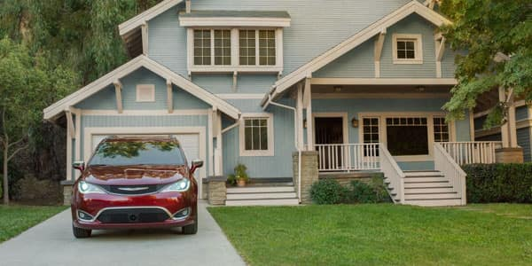 Chrysler Pacifica Parked in Driveway in Front of Home