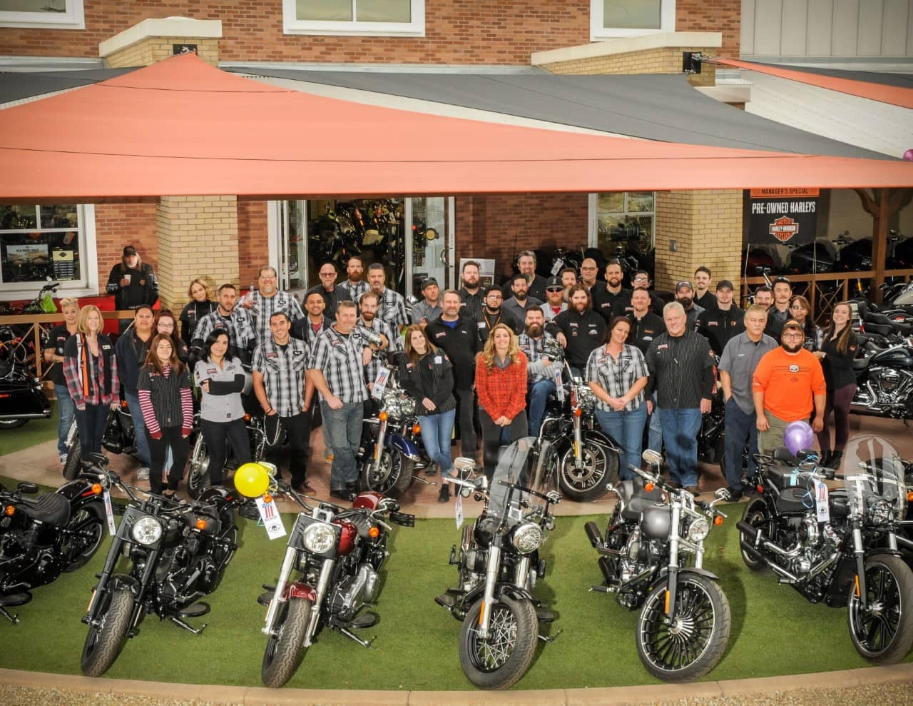 Wide angle group photo of the staff working at Chandler Harley-Davidson.