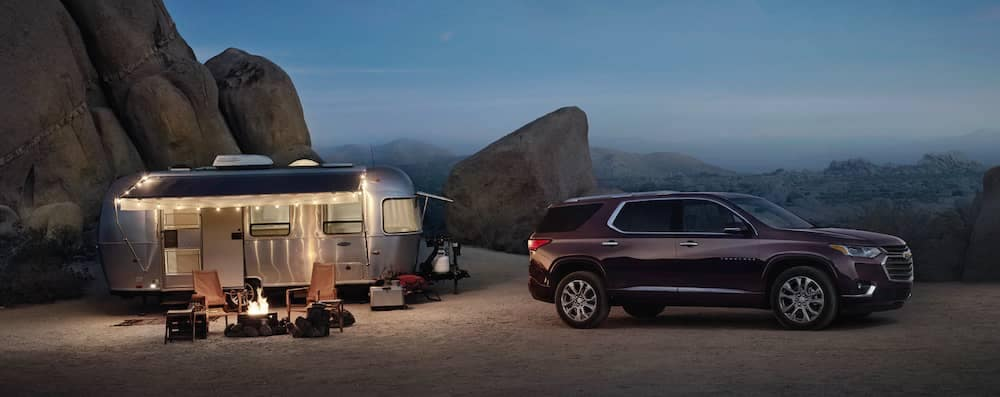 Chevy traverse parked on mountain with RV