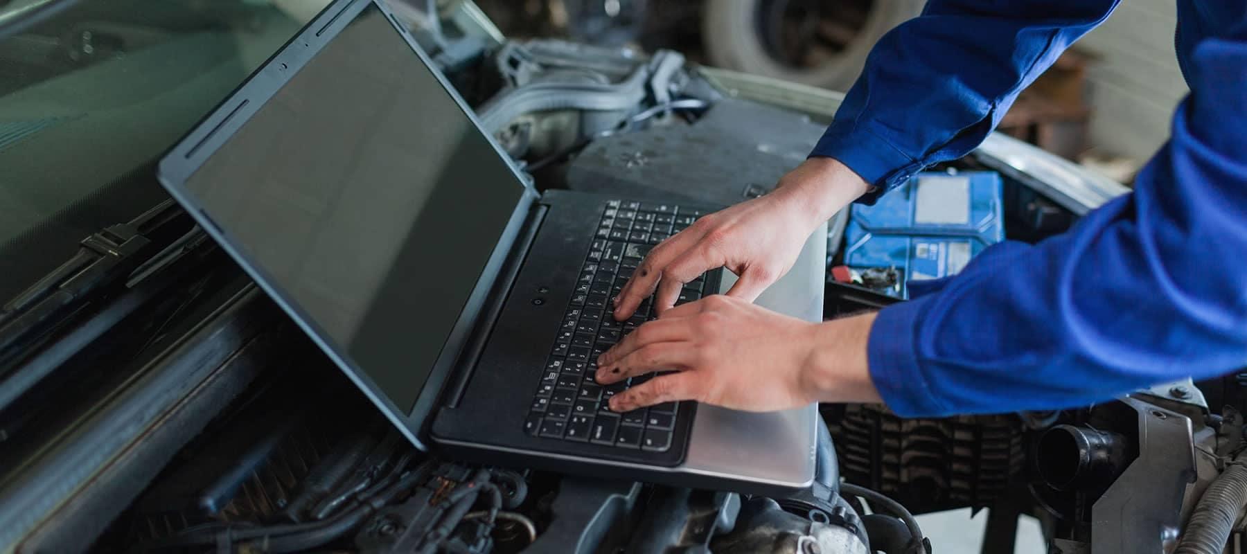 mechanic using a computer