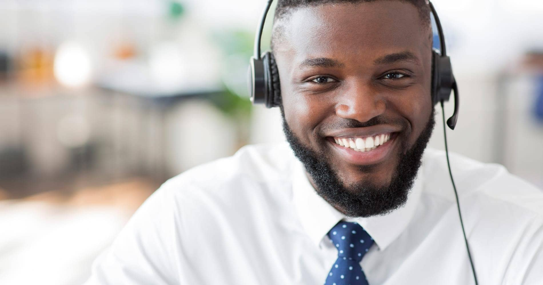 worker with a headset on and smiling