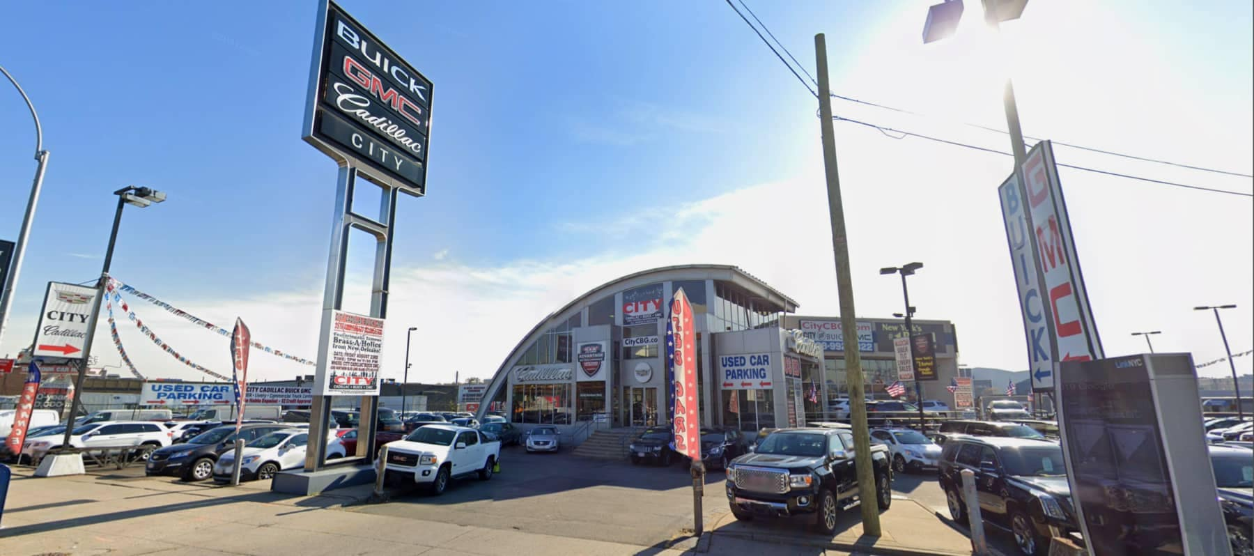 a picture of the front of City Buick GMC during the day