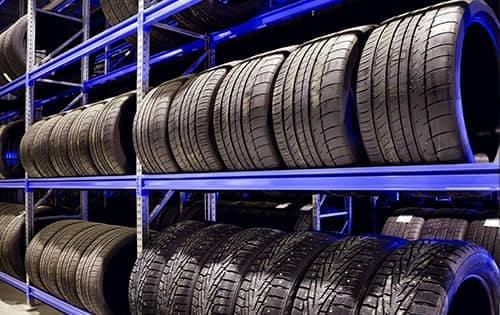row of tires on a shelf