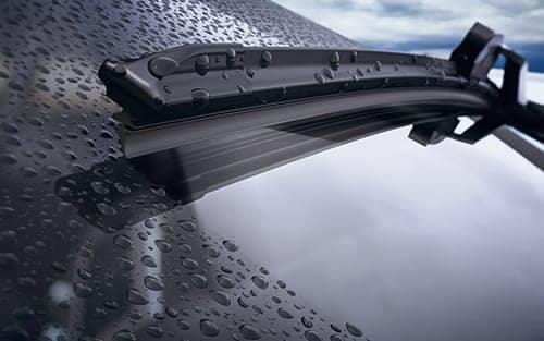 wiper blad on rainy windshield