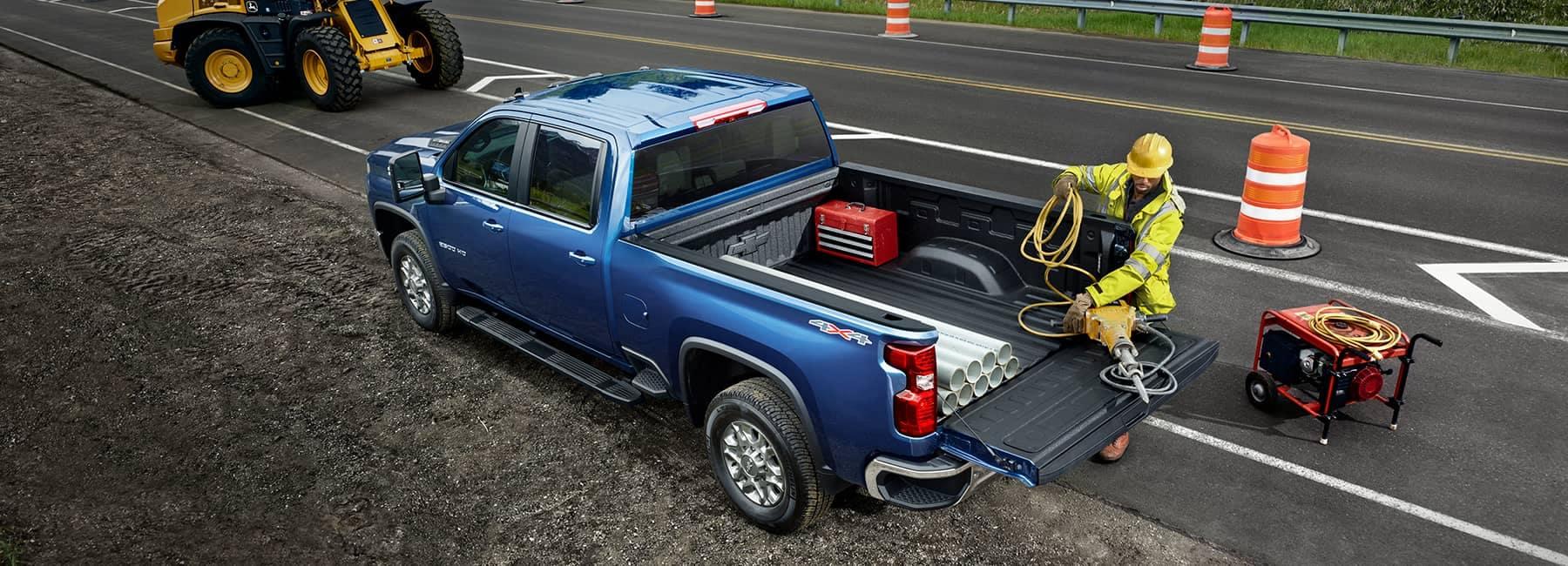 Blue 2021 Chevrolet Silverado 2500HD Crew Cab on a Roadside Work Site