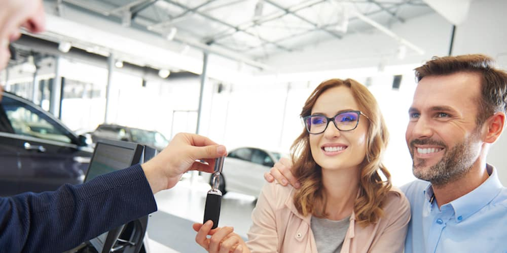 Couple getting keys to car