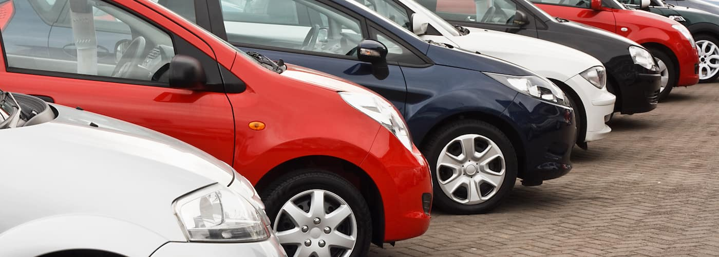 Used Cars Lined Up on Pavement