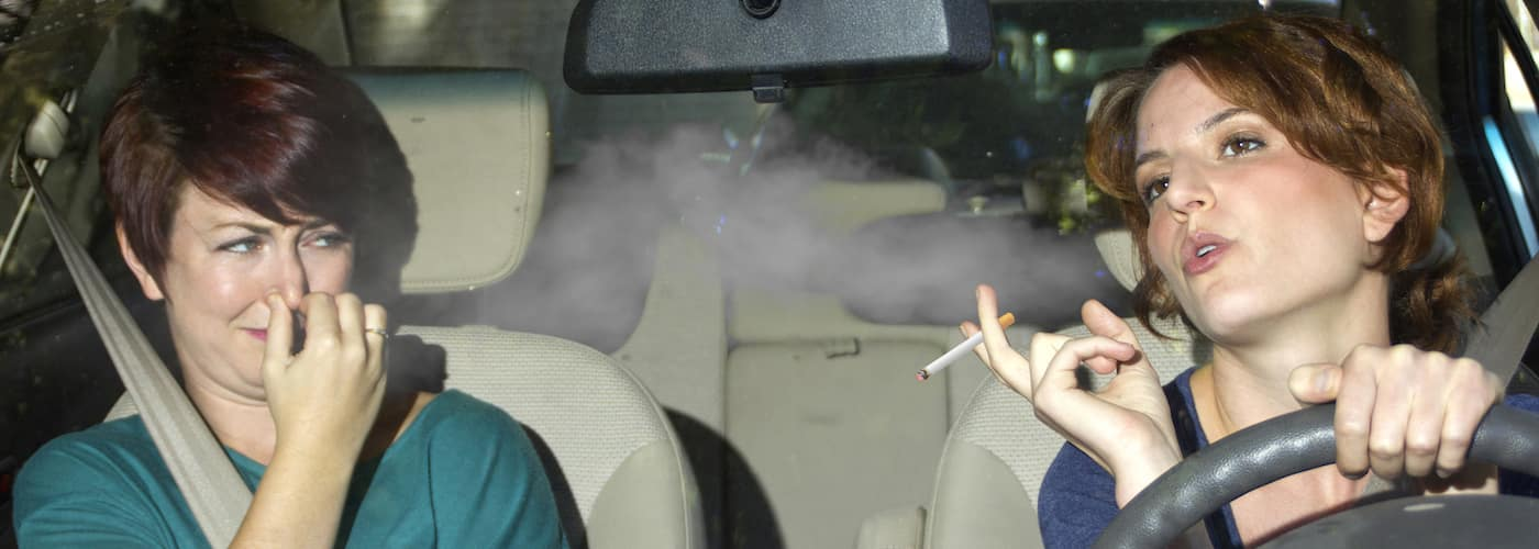 Woman Smoking in Car