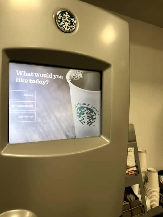 Self serve coffee machine in use