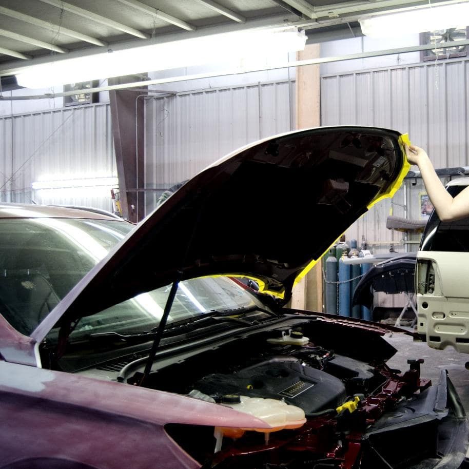 engine hood mid-repair
