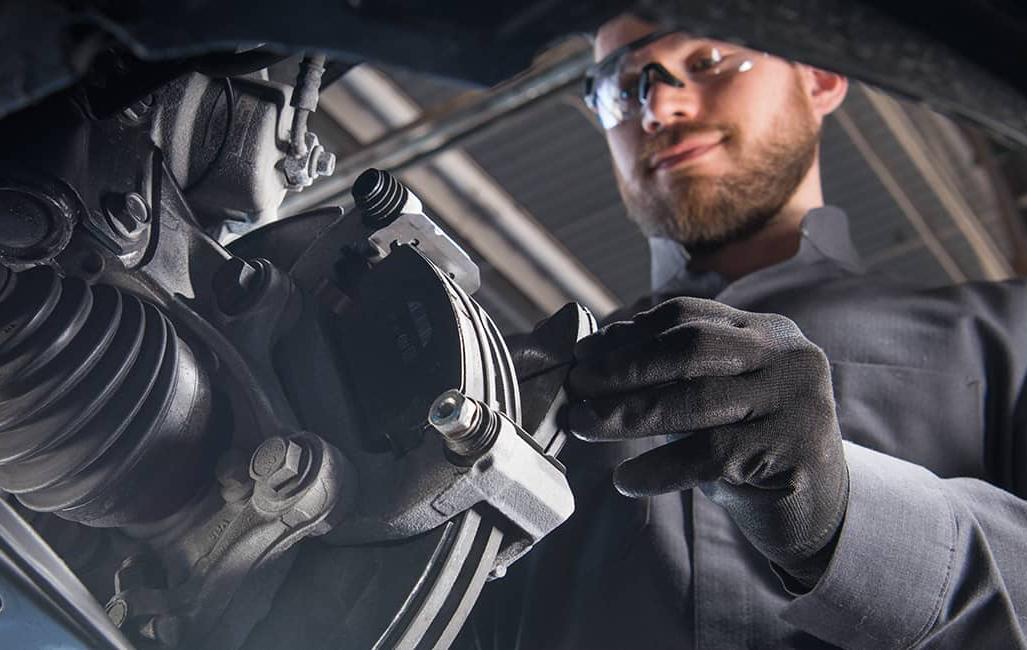 technician installs new brakes
