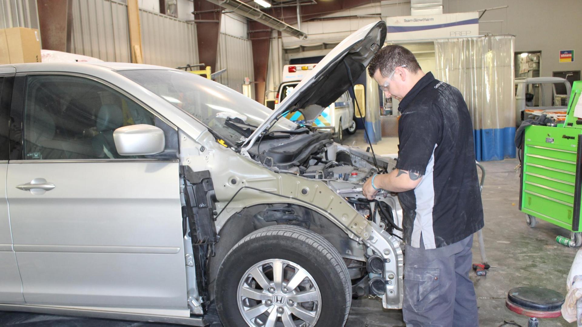 engine body of hood mid-repair