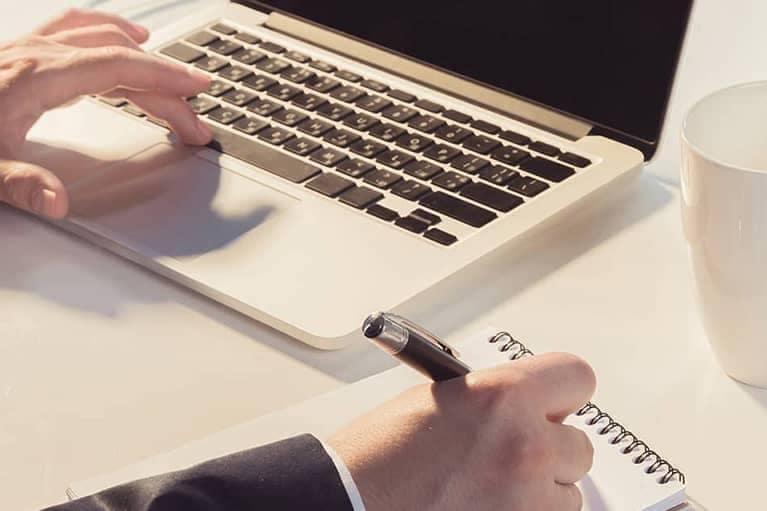 man's hands on keyboard