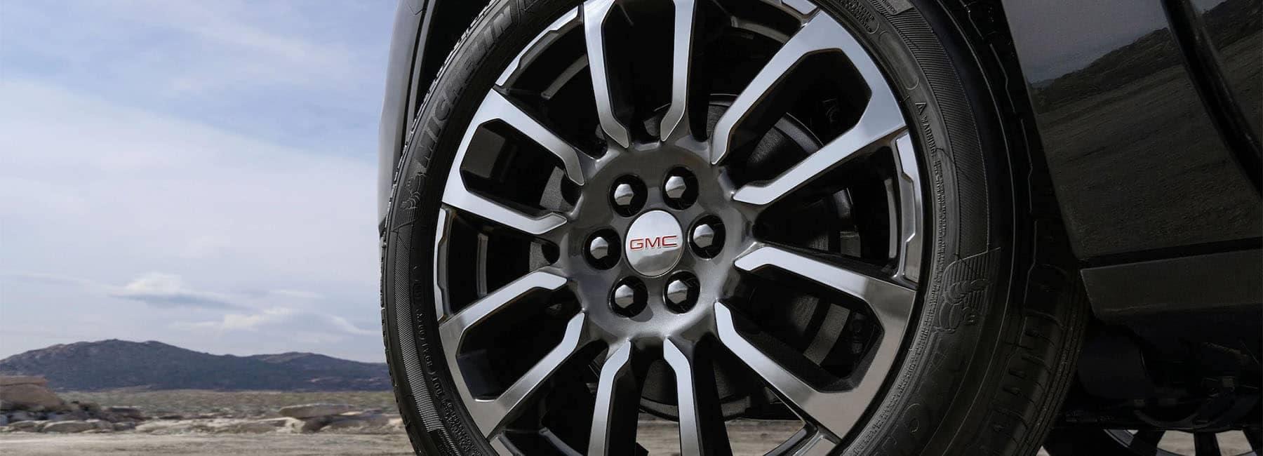 2020 GMC Acadia Denali Luxury SUV exterior front wheel