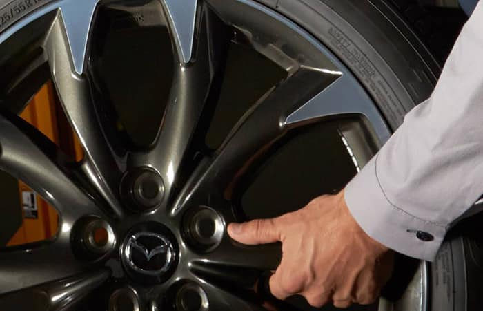 Hand holding Tire