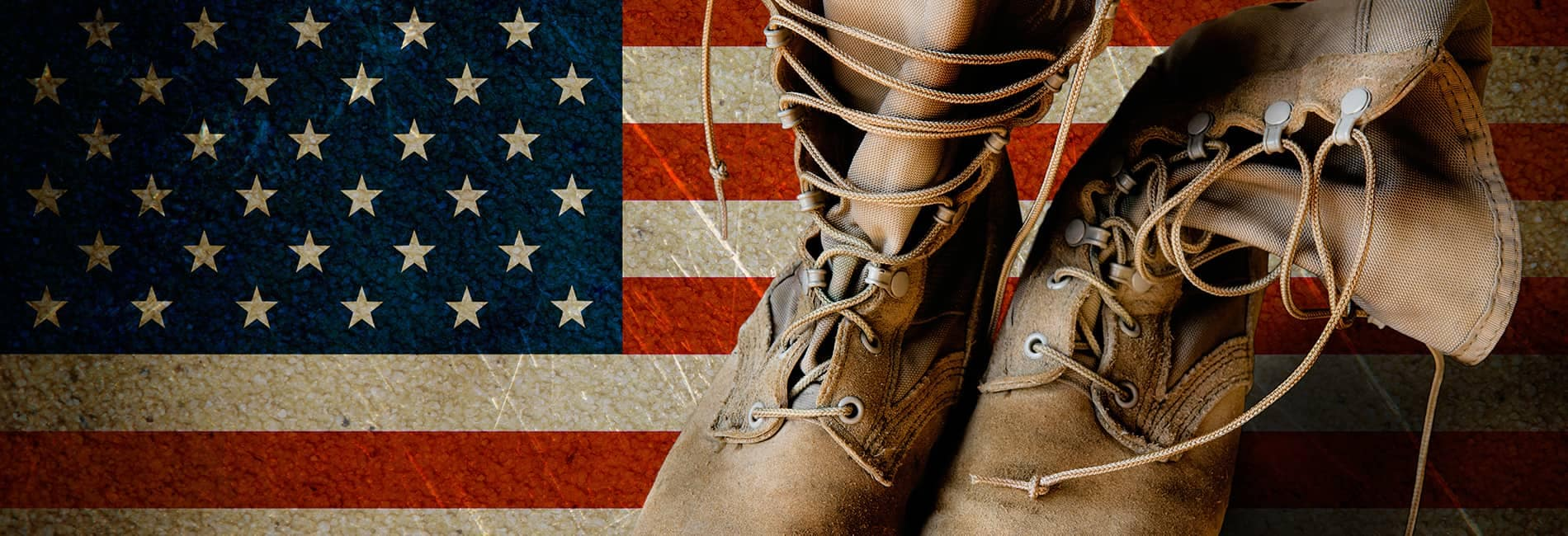 Military style boots on top of an American flag background
