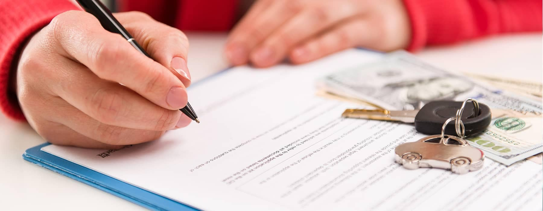 A person looking over financial documents before signing them