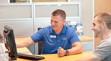 A Hendrick employee helping a customer through financing