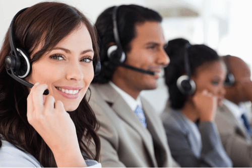 customer service reps talk on their headsets