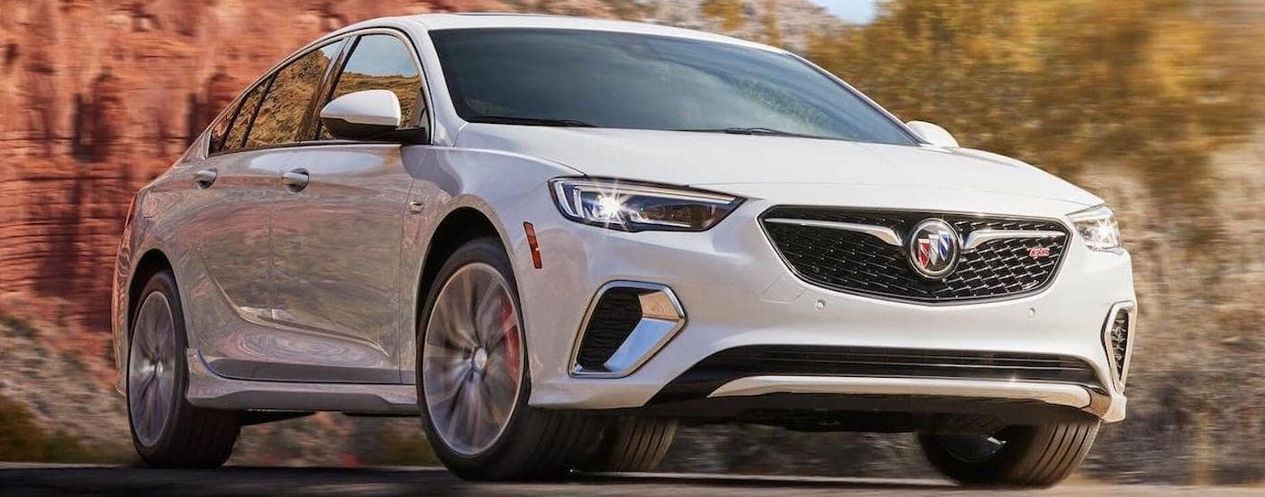 A white 2020 Buick Regal GS is driving on a highway near Lexington, KY.