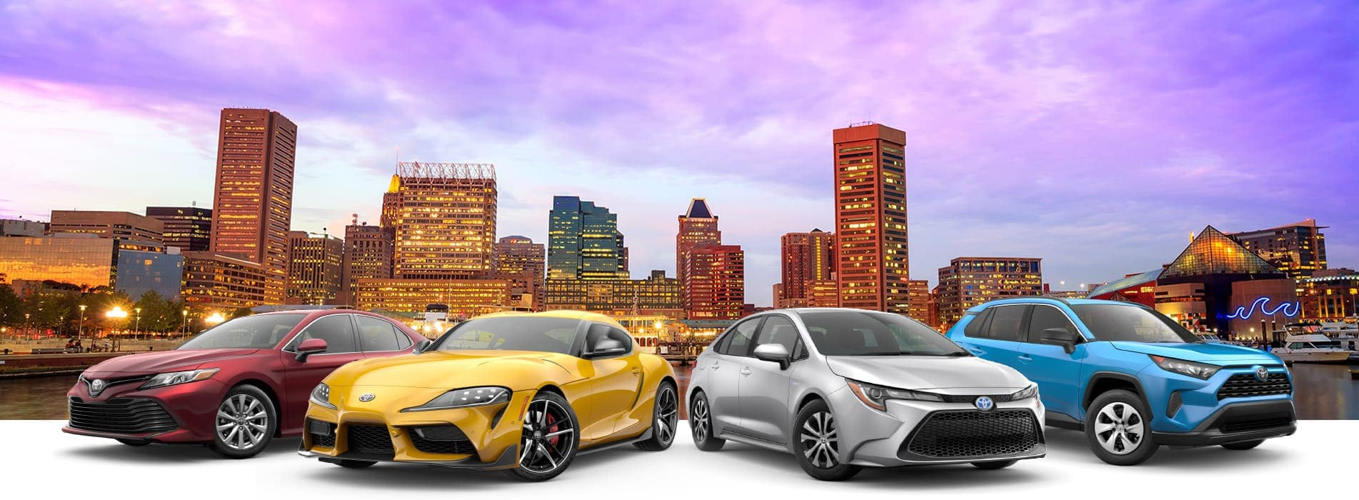 Toyota vehicle line-up against a background with the Baltimore skyline