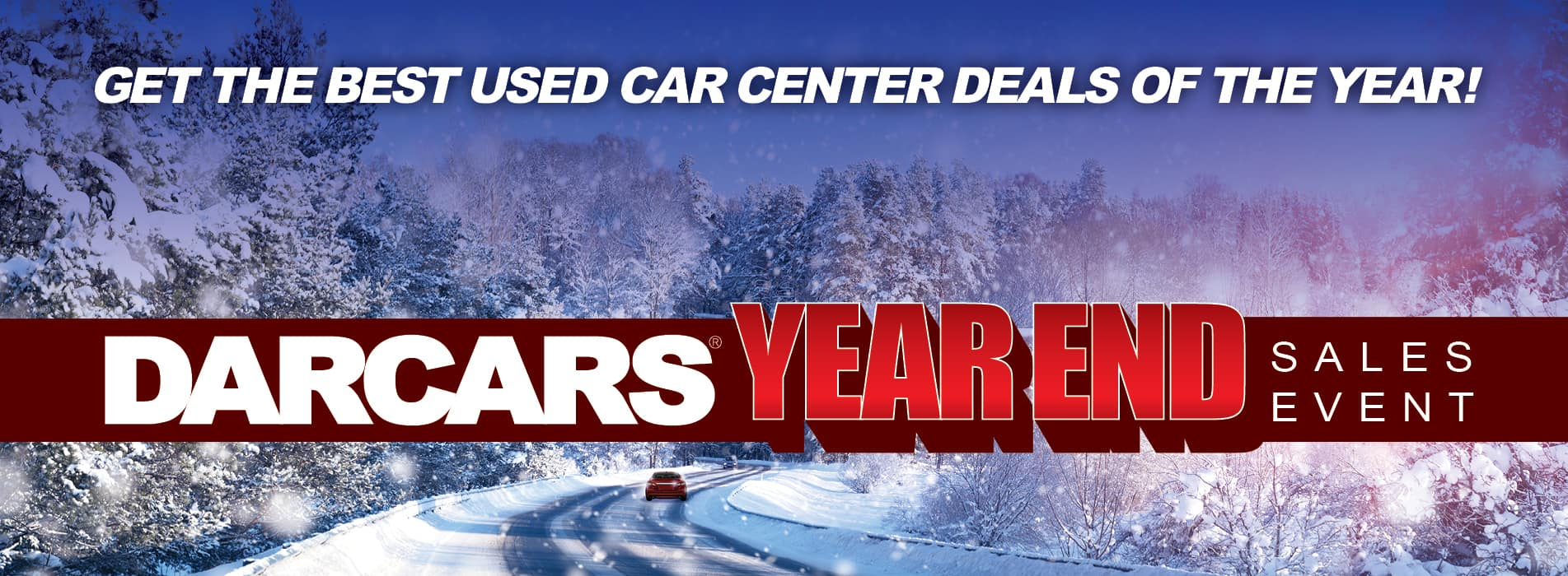 Get the best used car center deals of the year - DARCARS year end sales event banner with red car driving through snow covered forest in the background