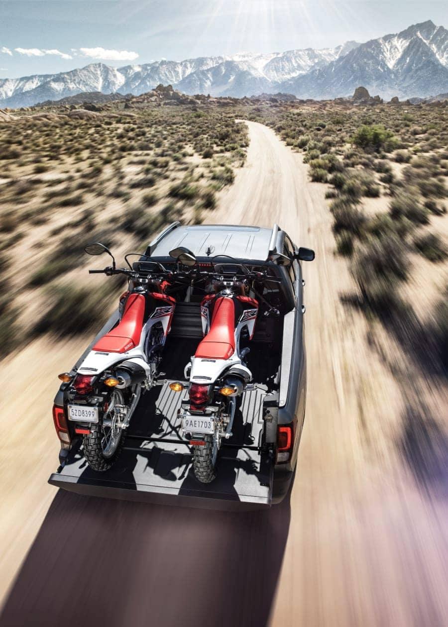 Honda in desert trail