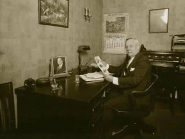 Oliver Joseph at a desk, old photo