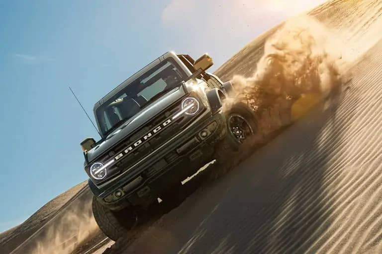 Bronco plowing down sand dune