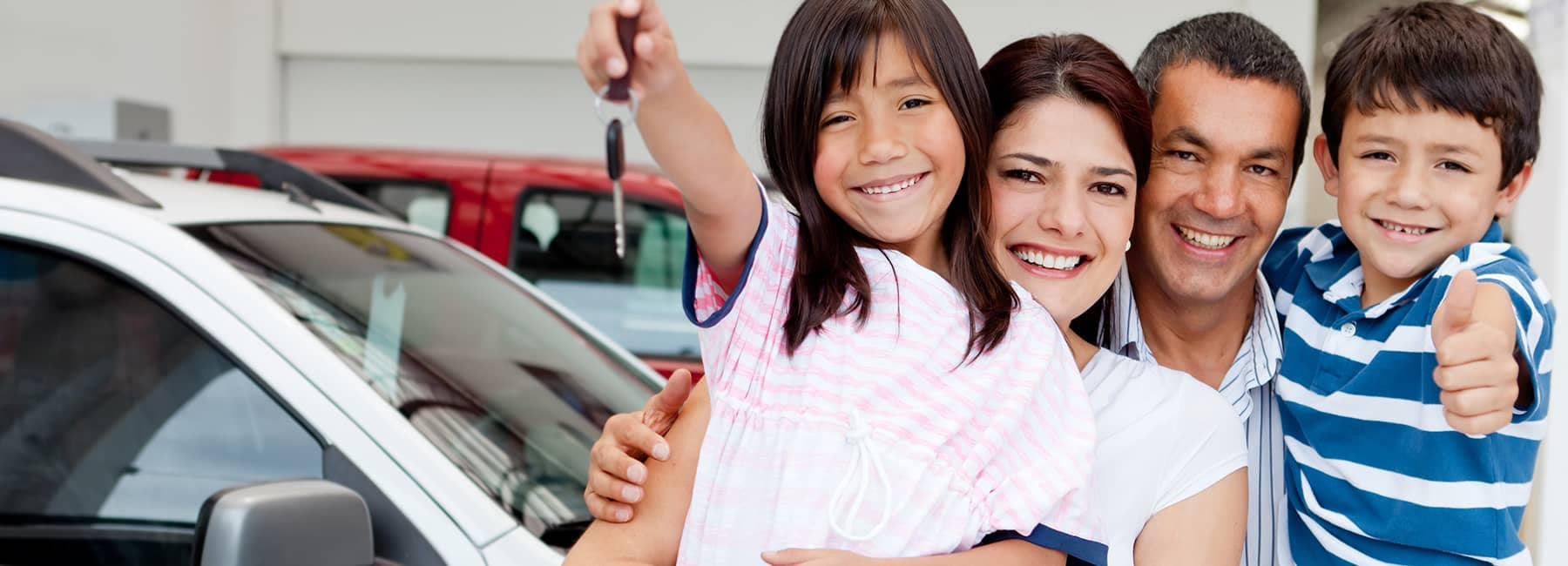 happy family holding new car keys