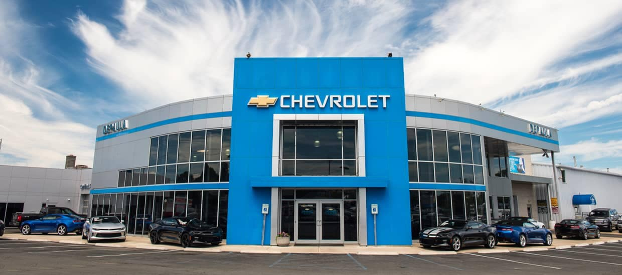 An exterior shot of a Chevrolet dealership during the day.
