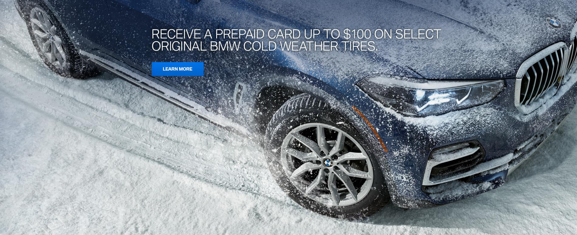 Blue BMW X5 with V-Spoke Style 734 Silver  wheels driving over snow covered ground leaving tire tracks in the snow.