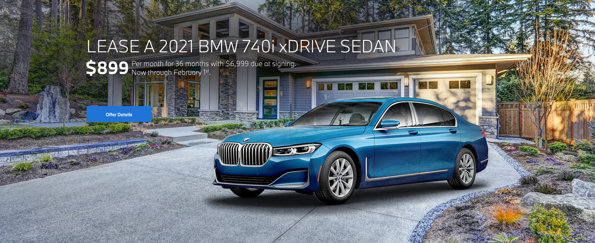 Blue 7 series parked in driveway