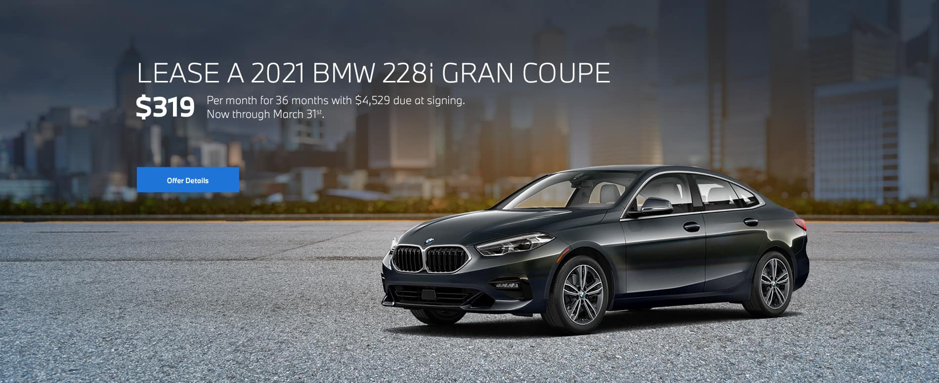Dark Grey 2 Gran Coupe with cityscape background
