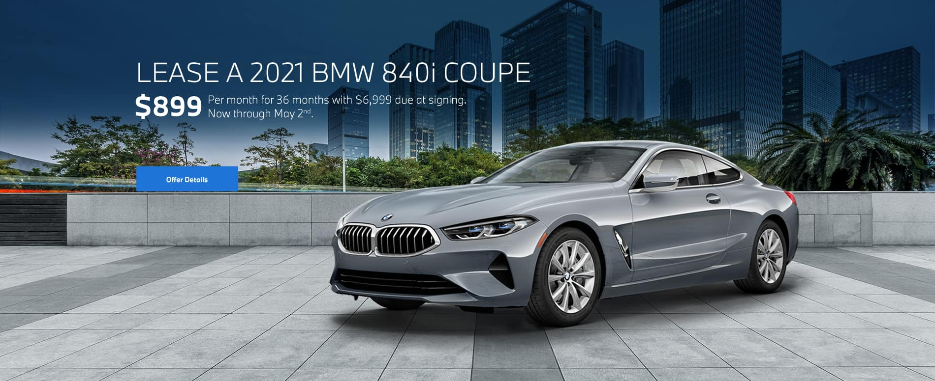 8 series coupe with cityscape background