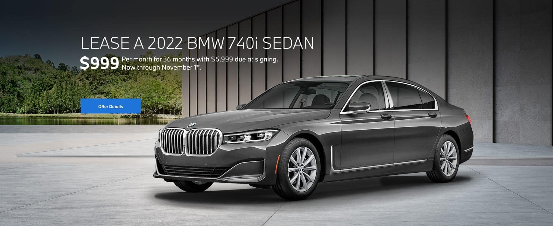 Grey 7 series parked outside modern building