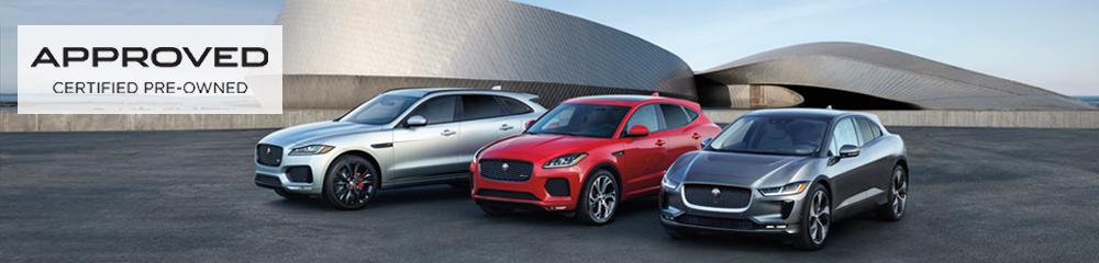 (left to right) Gray Jaguar SUV, red Jaguar SUV, gray Jaguar car