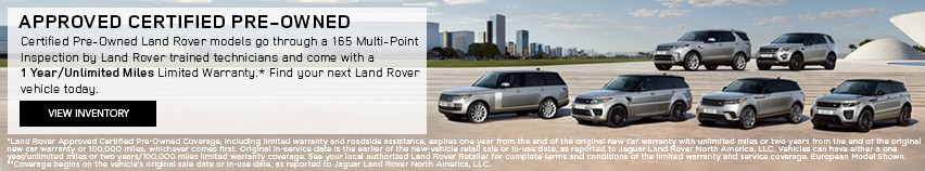 Land Rover Certified Pre-Owned vehicles in front of city landscape