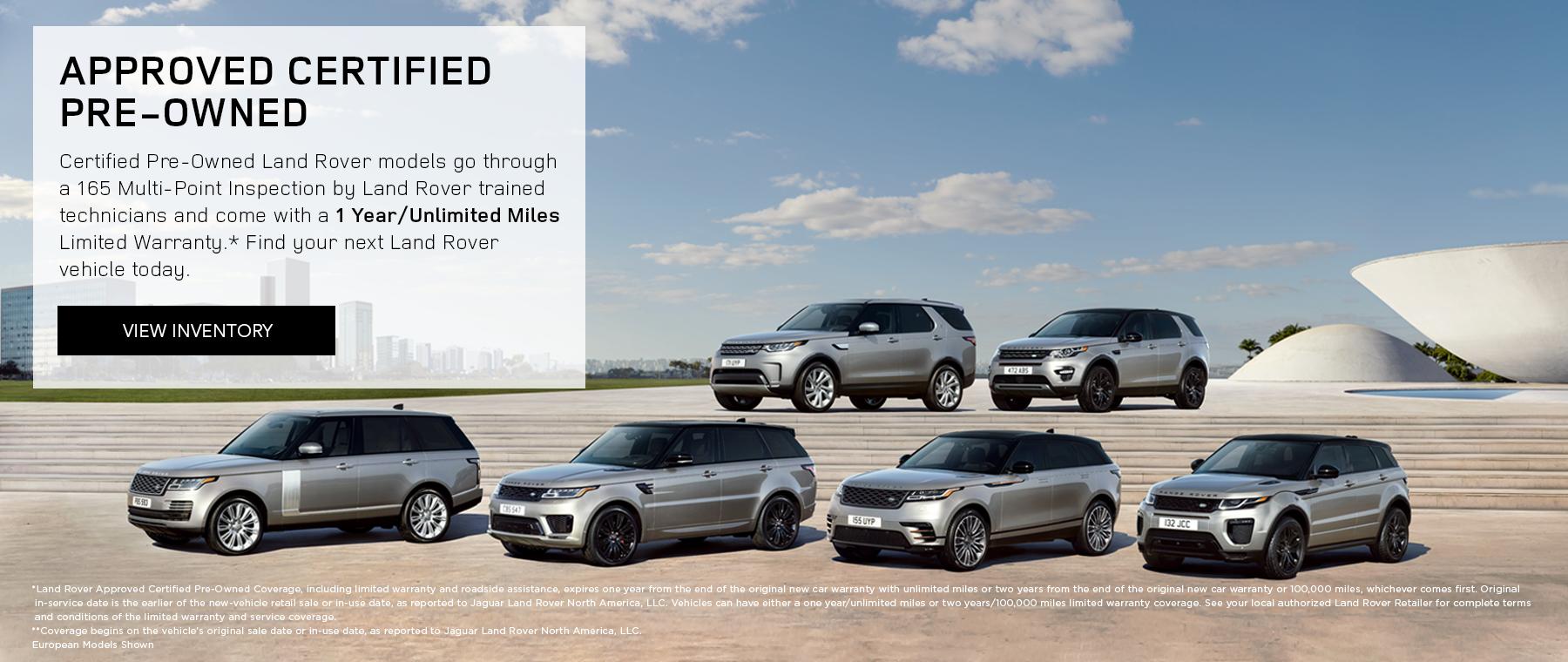 Land Rover model range in front of city landscape