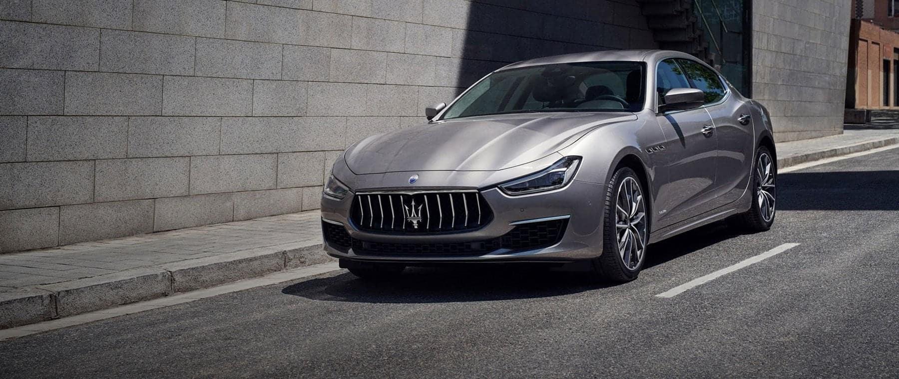 Gray Maserati on city road