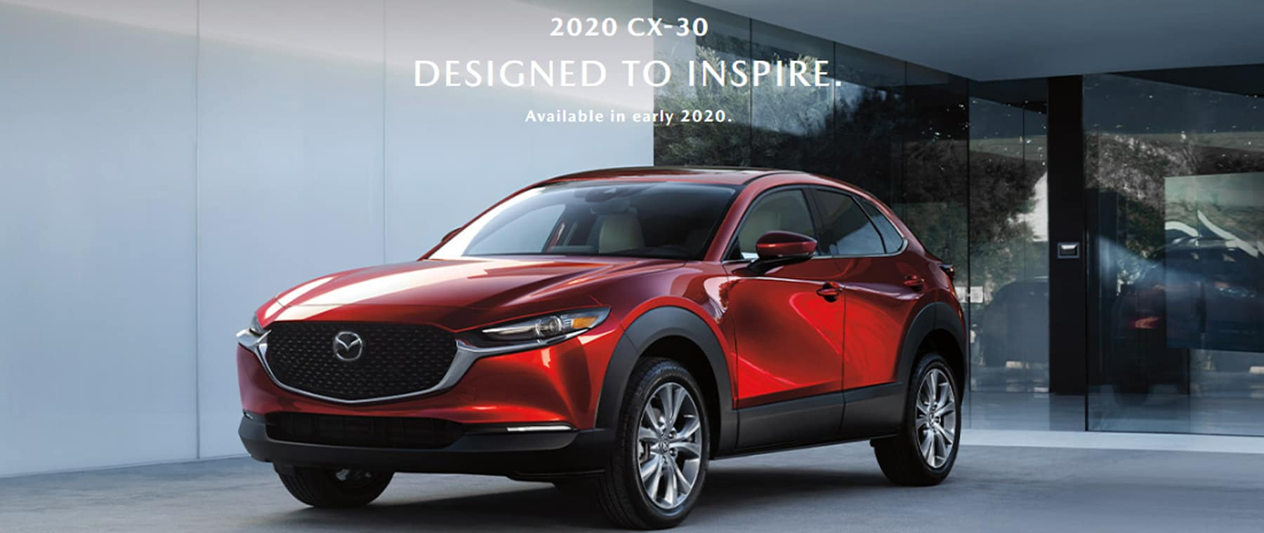red cx-30 in front of glass window