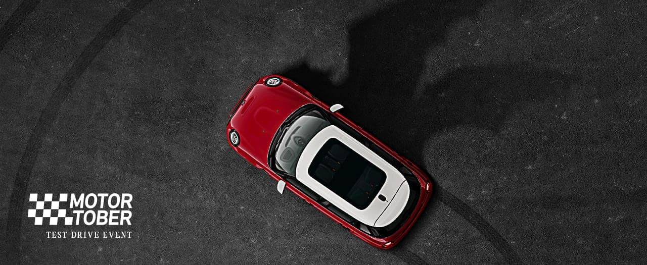 Overhead shot of MINI with bat silhouette and Motortober Test Drive Event logo.