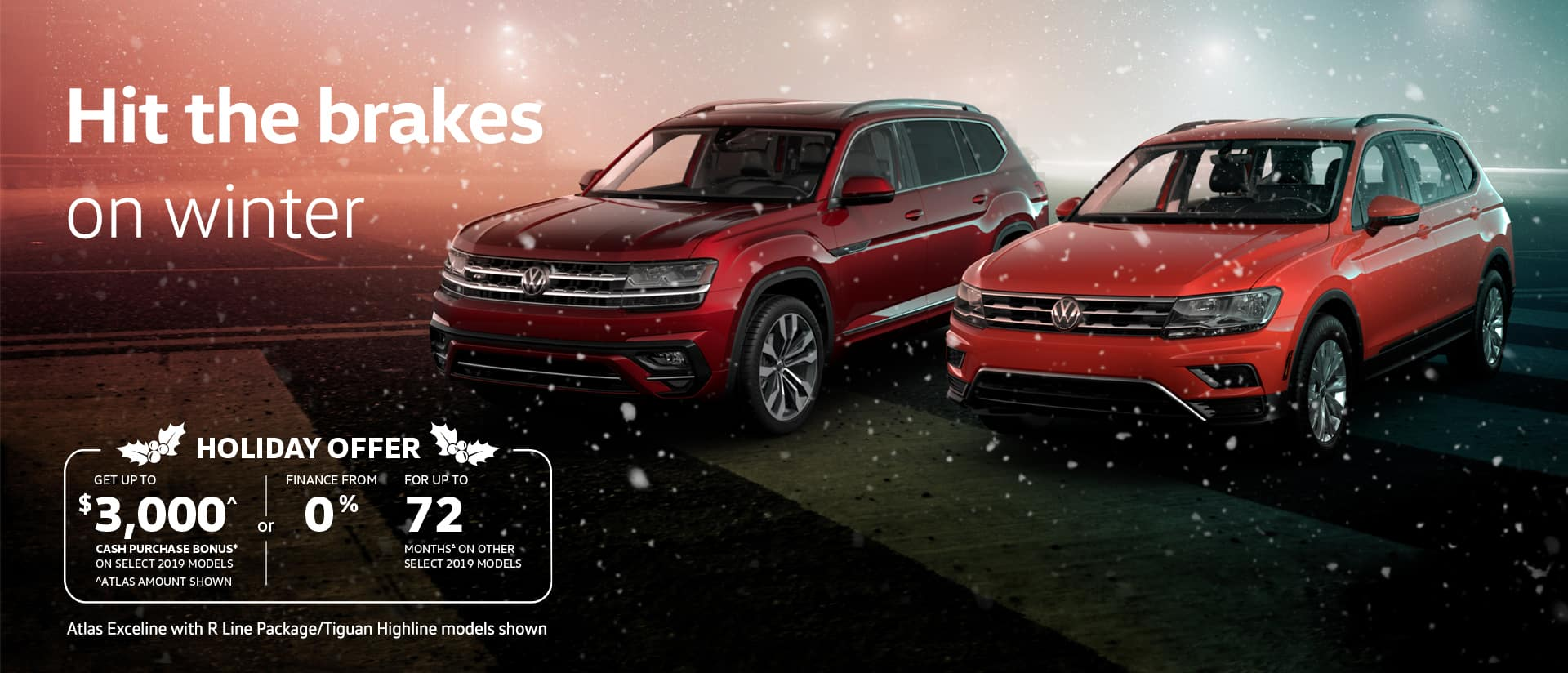 red and orange volkswagen suvs with snowflakes falling