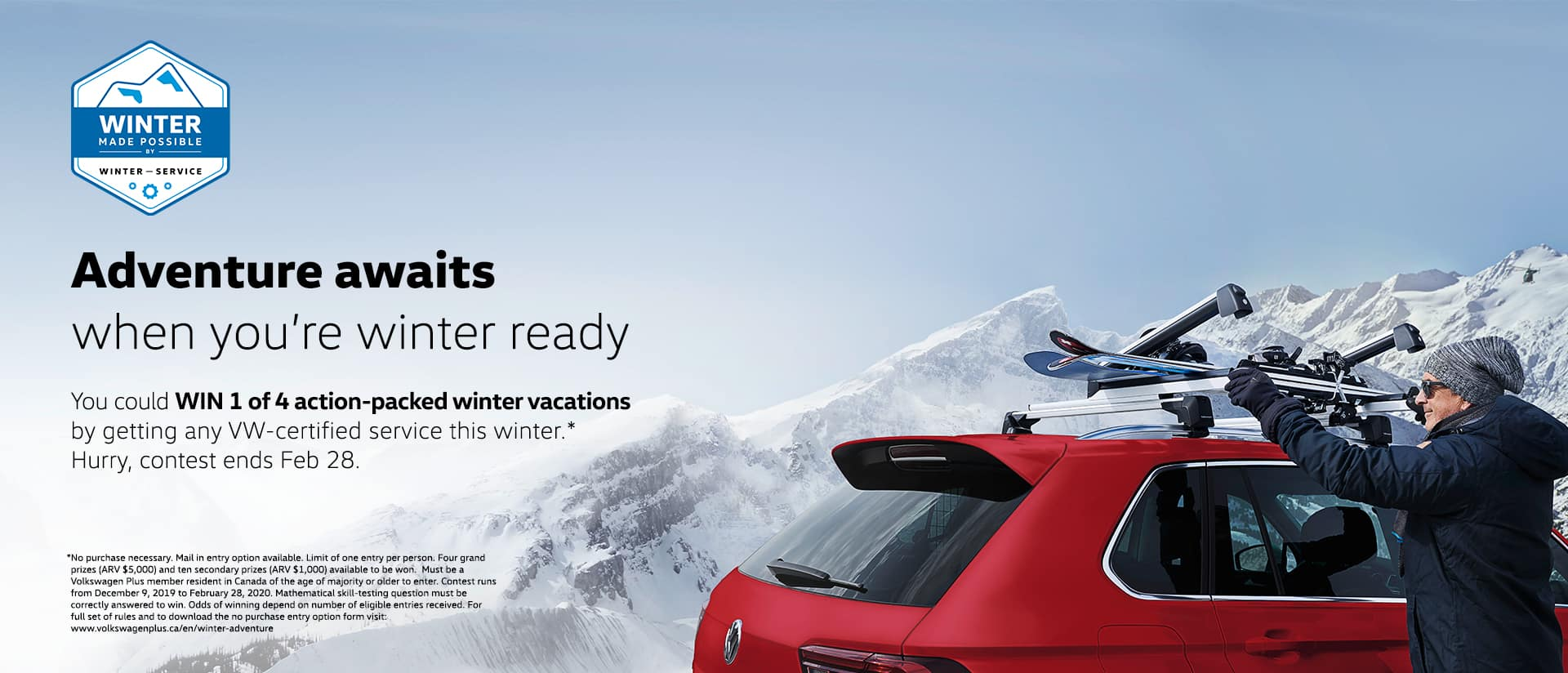 roof of red volkswagen with man loading ski equipment on roof